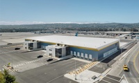 Design/Build, New, 80,000 SF high bay, 400-foot long span cargo handling and office facility.